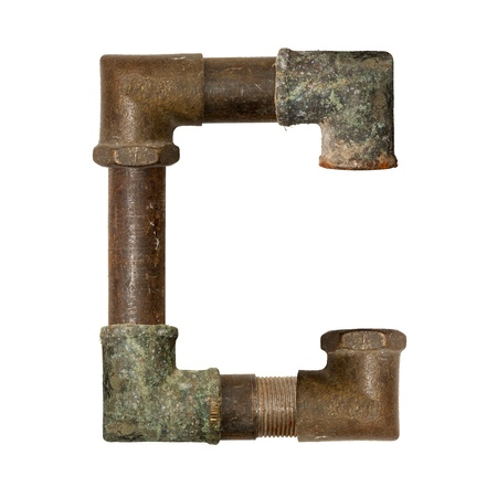 The alphabet of the ancient pipe isolated on white photo