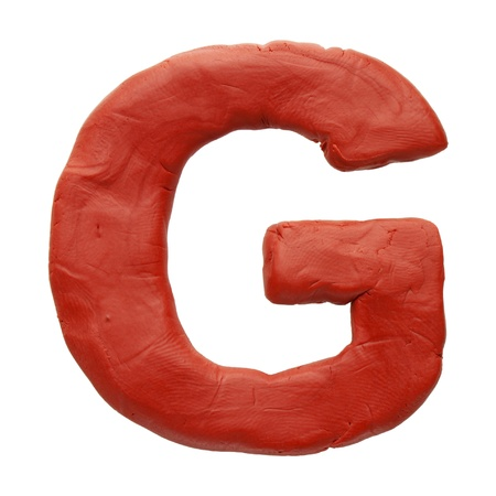 Colour plasticine letter isolated on a white background photo