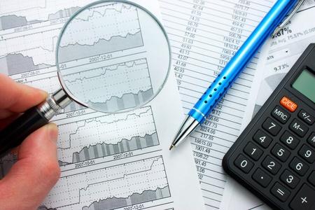 Examining stock prices photo