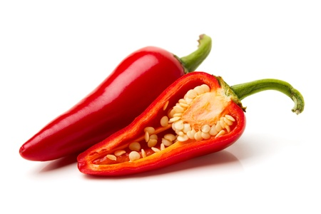 hot peppers: Two red hot peppers over white
