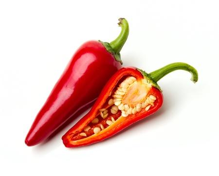 chiles picantes: Dos pimientos rojos calientes sobre blanco Foto de archivo