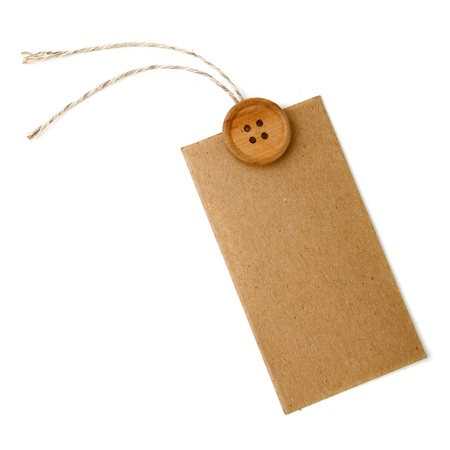 Blank tag tied with string and wood button. Price tag, gift tag, sale tag, address label photo
