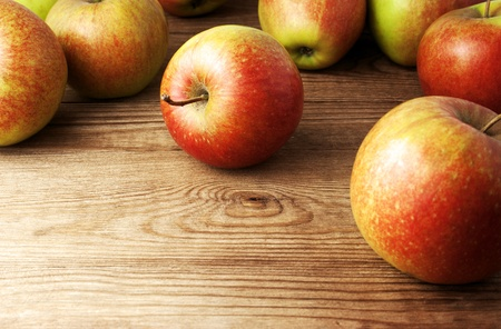 red apples on wooden table photo