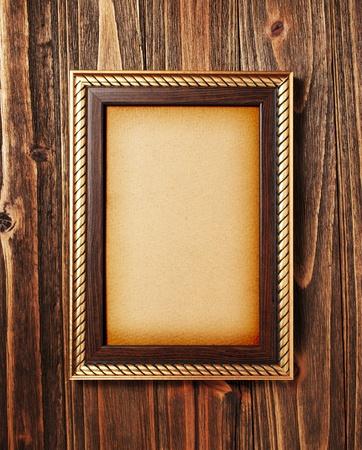 frame wood: ancient style golden photo image frame on wood background Stock Photo
