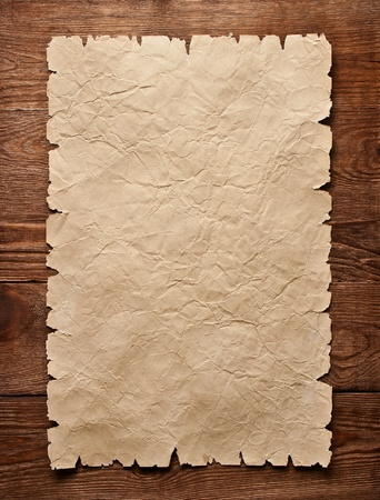 old paper on wood background Stock Photo - 11316563