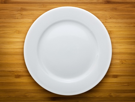 dinner plate: Plate on wood background  Stock Photo