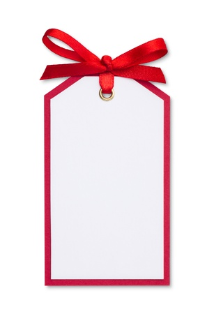 christmas gift: close up of card note with red ribbon on white background  Stock Photo