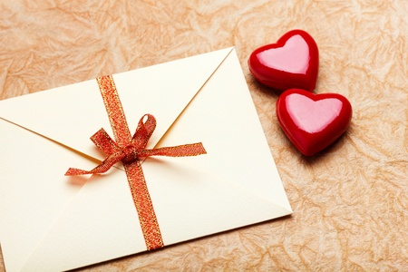 Envelope with valentine card on paper background  photo