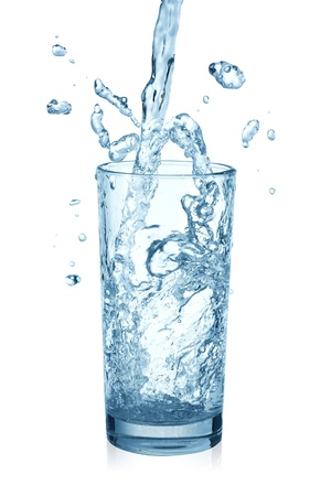 puring water on a glass on white background photo