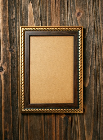ornamentation: ancient style golden photo image frame on wood background