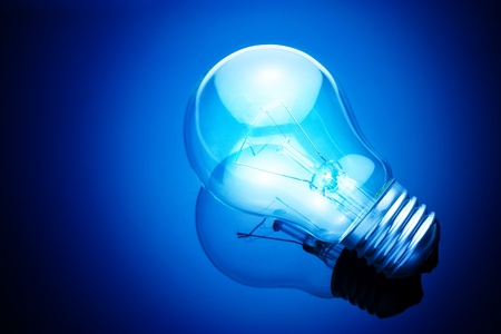 light bulb on blue background photo