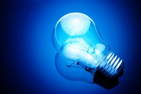 electric bulb: light bulb on blue background