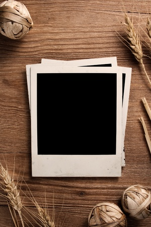 Old photo frames on wood background with wheat photo