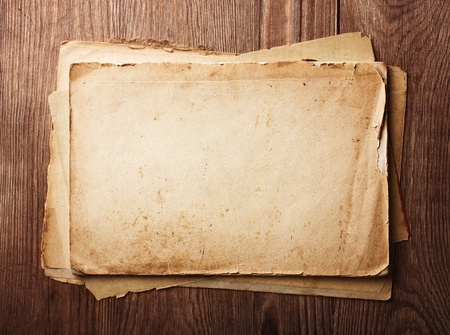 worn: Stack old papers on a wooden table  Stock Photo