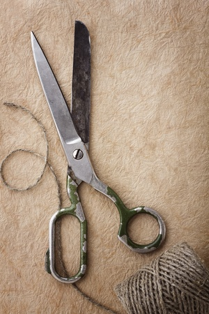 antique scissors: Sewing tools on paper background Stock Photo