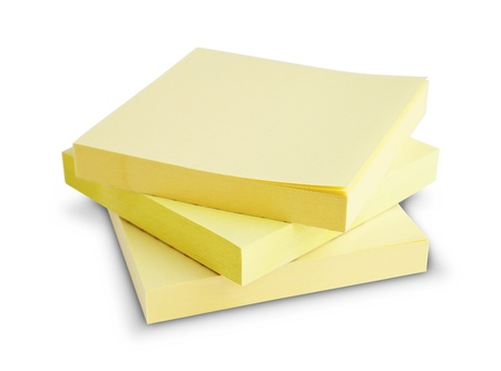 Block of yellow Post it Notes isolated on white photo