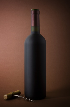 wine bottle and corkscrew on a paper background photo