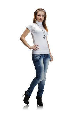 Full-length portrait of beautiful girl in jeans and white t-shirt photo