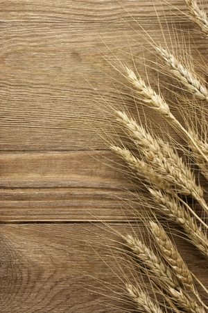wheat on the wood background Stock Photo - 12770773