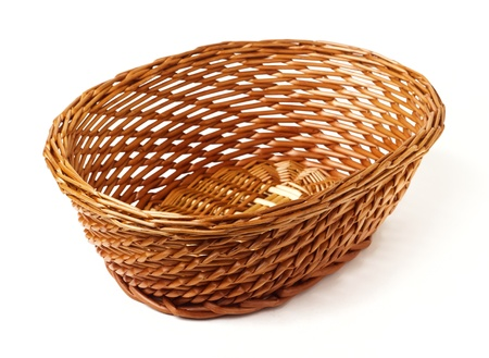 hand woven: wicker basket isolated on white background