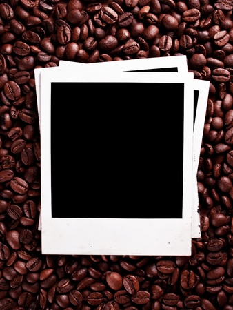 Old photo frames against the backdrop of coffee beans photo