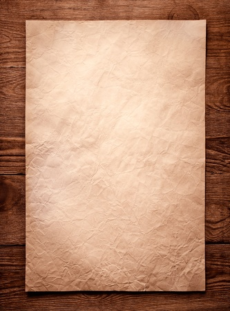 ancient scroll: old paper on brown wood texture with natural patterns Stock Photo