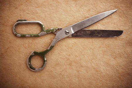 Old scissors on the paper texture photo