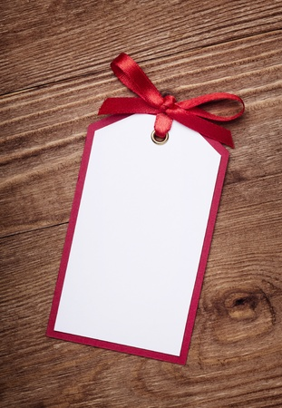 address card with bow on old wooden background  photo