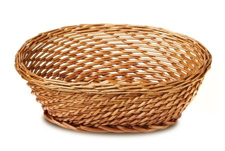 wicker basket isolated on white background photo