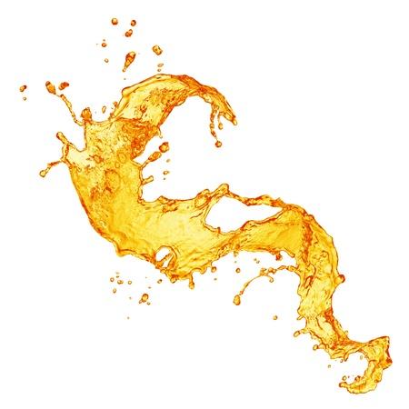 verre de jus: �claboussures de jus d'orange Banque d'images