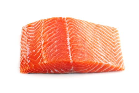 salmon dinner: raw big salmon bar over white background