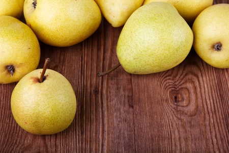 pears on old wooden background photo