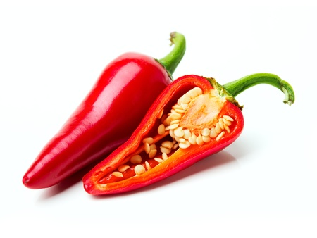 Two red hot peppers over white photo
