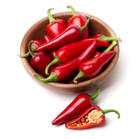 Red Hot Chili Peppers in bowl over white background photo