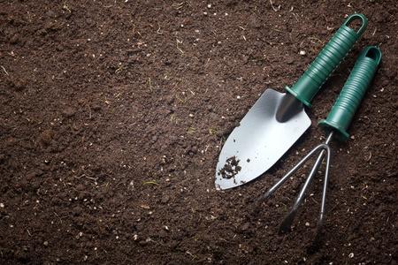 Soil with shovel photo