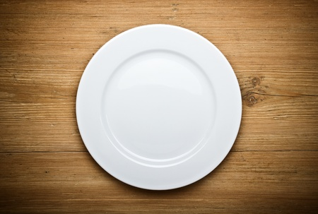 plate: Empty white plate on wooden table