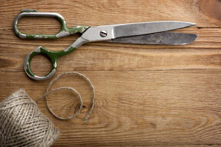 Old scissors on the wooden table Stock Photo - 13808768
