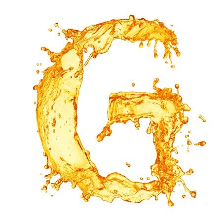 Oranje vloeistofspatten alfabet Stockfoto