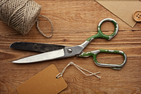 Old scissors and buttons on the wooden table Stock Photo - 13980762