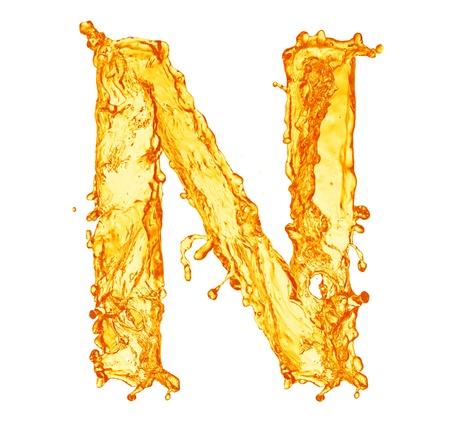 Orange liquid splash alphabet Imagens