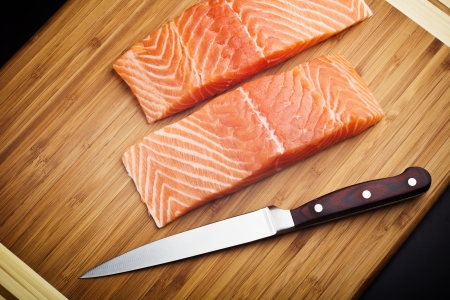 red salmon: salmon fillet with knife on wood board