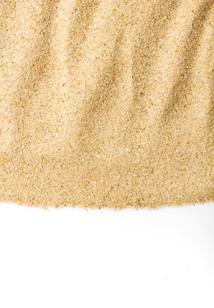 Sand scattering isolated on white background photo