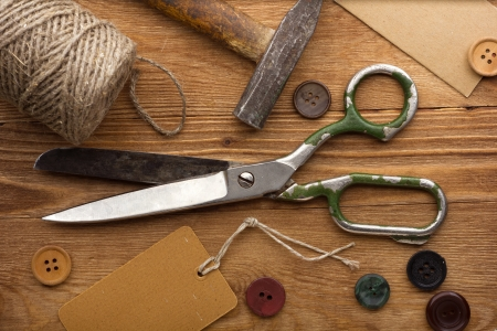 Old scissors and buttons on the wooden table Stock Photo - 14901347