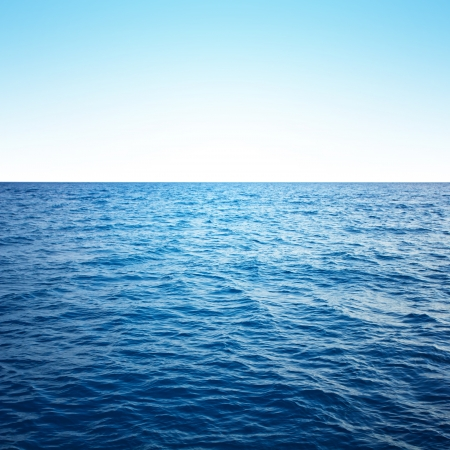 shore line: Blue sea with waves and clear blue sky Stock Photo