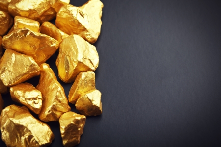 precious metal: gold nuggets on a black background. closeup