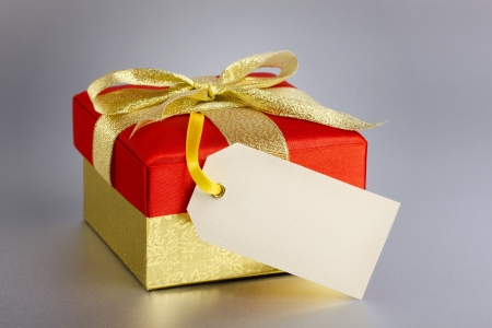christmas gift with blank tag  Stock Photo - 17373215