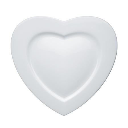 Hart vorm witte plaat geïsoleerd op witte achtergrond