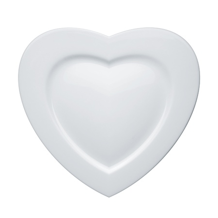 Heart form white plate isolated on white background Imagens