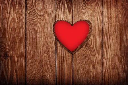 Wooden door close-up, heart shape photo