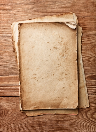 stack of old papers on wood textures background Stock Photo - 17901329